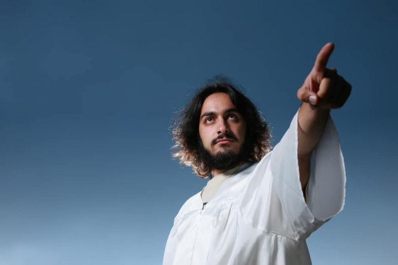 picture of a Man looking like Jesus pointing his finger,